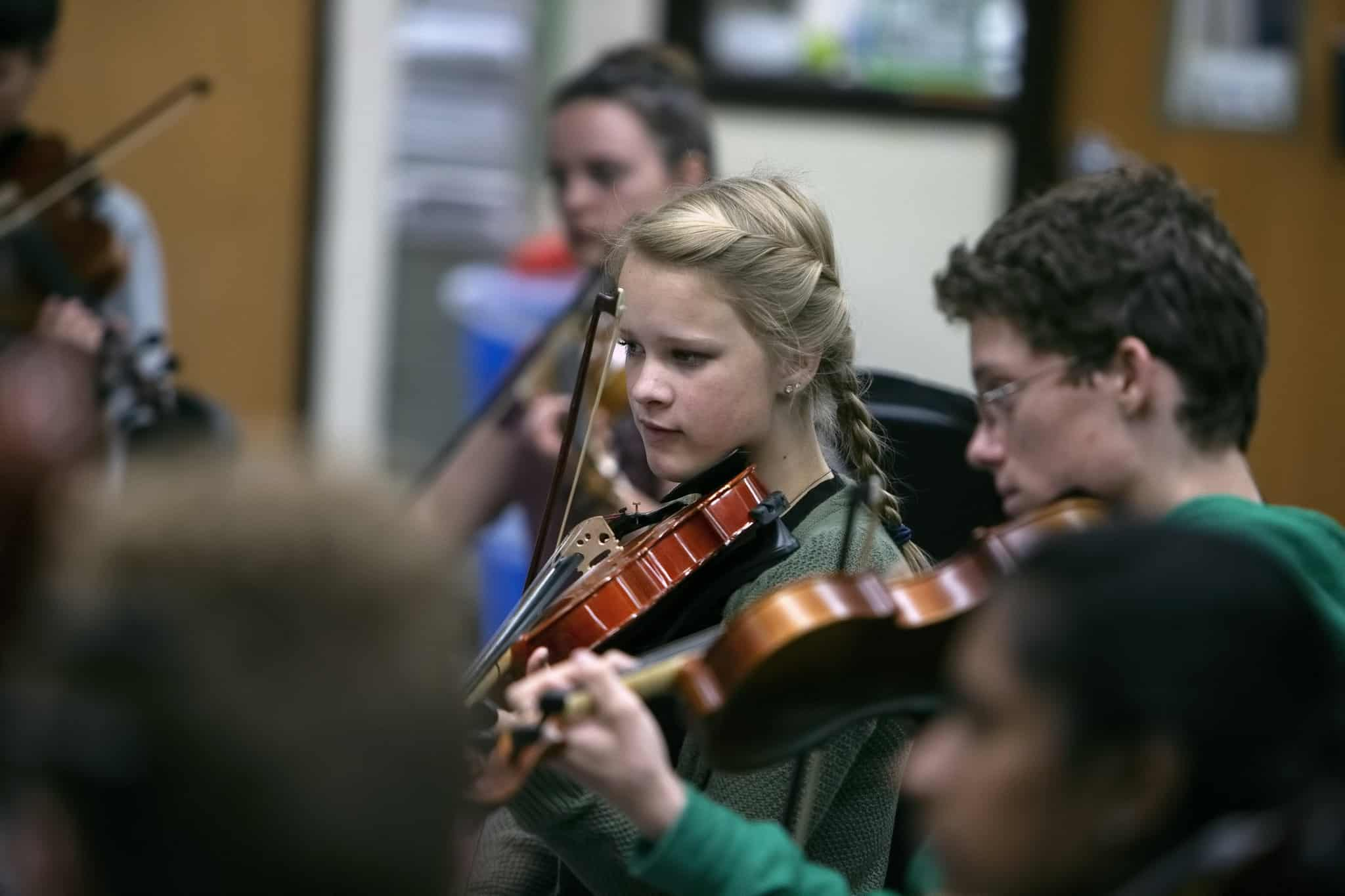 students playing violins